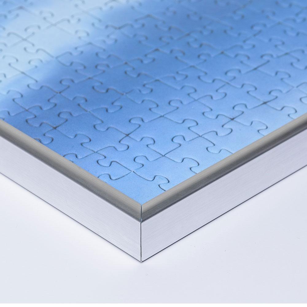 Cornice per puzzle su misura fino a 100x100 cm in materiale sintetico argento | vetro artificiale antiriflesso